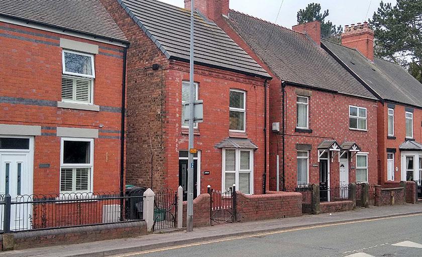 Acrefair houses in red and black brick